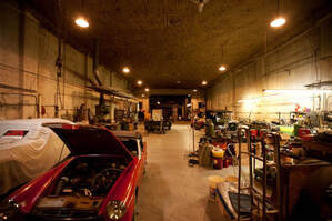 The Vox Theatre as an antique car garage